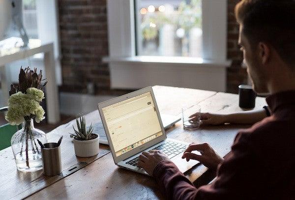 Man at computer / online reviews